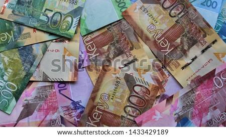 Pile of various Kenyan shilling notes, top view.