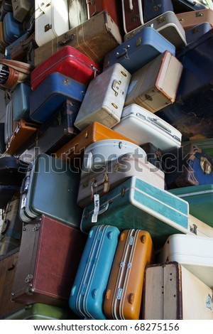 Pile of various styles of old luggage at airport or train station
