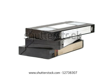 Pile of VHS video cassettes isolated on white