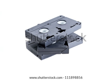 Pile of videotapes on  white background.