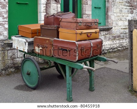 Pile of vintage luggage on railway porters trolly