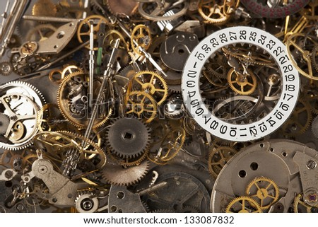 Pile of watch parts with date ring on top