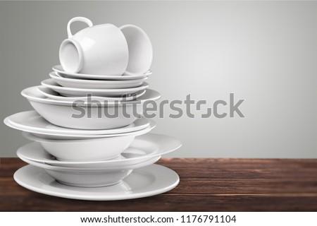 Pile of White Dishware on desk #1176791104