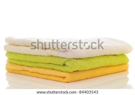 pile of white lime and yellow towels