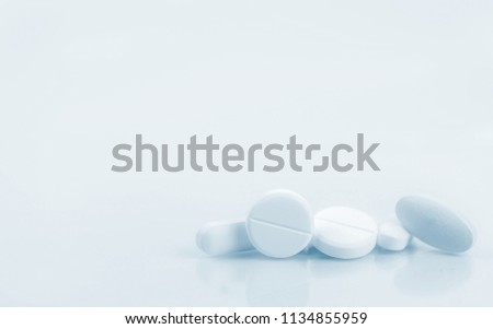 Pile of white round, oblong, and oval shape tablet pills isolated on white background. Pharmaceutical industry. Pharmacy or drugstore sign and symbol. Pharmacy background. Health and pharmacology.