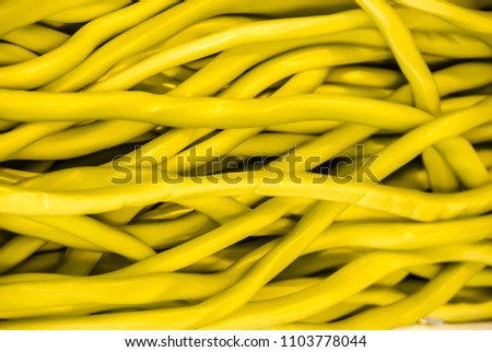 Pile of yellow ethernet network cables #1103778044