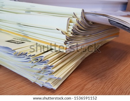 Pile of yellow exam script booklets