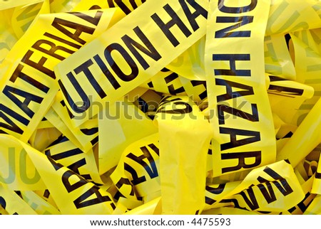 Pile of yellow plastic tape marked Cautious Hazardous Material