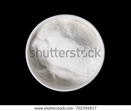 Pile rice flour in bowl isolated on black background #702396817