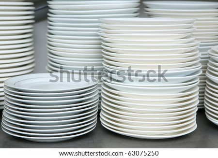 pile stack of clean washed dishes and plates