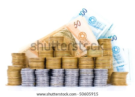 Pile with coins and brazilian currencies .