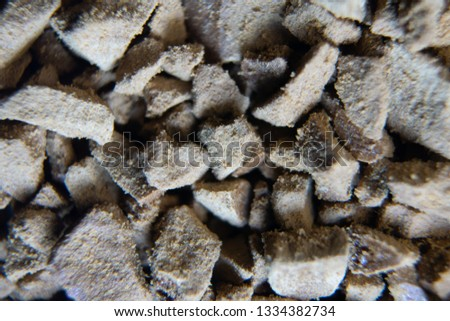 Piled granules texture background. Instant coffee closeup macro background