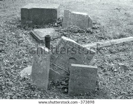 piled up broken grave stones in cemetary no longer used