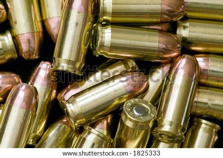 Piles of 308 calliber hollowpoint bullets.