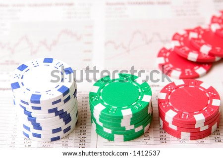Piles of casino chips on top of a financial newspaper.
