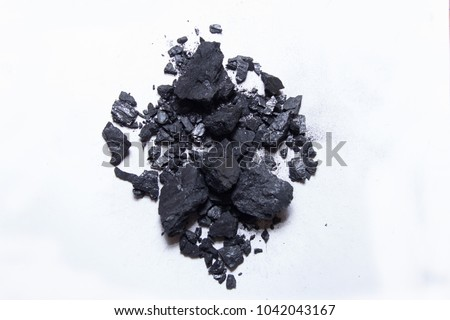 piles of charcoal isolated on white background, xylantrax, charcoal, top view. coal. brown coal.