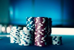 Piles of chips on the poker table, winning and casino concept