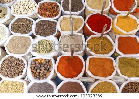 Piles of colorful spices, Anjuna market, Goa, India.