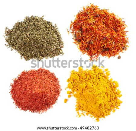 Piles of different spices on white background