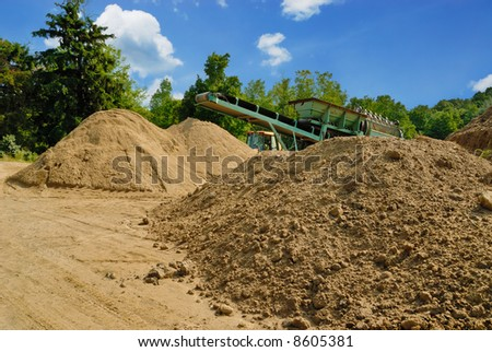 Piles of dirt being sifted for construction