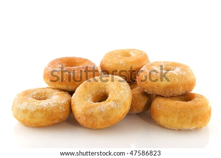 piles of donuts with sugar isolated over white