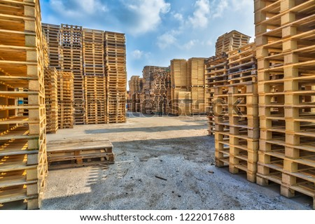Piles of euro type cargo pallets at a recycling business area