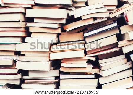 piles of old books in the flea...