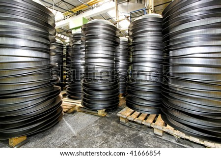 Piles of pan blanks in factory warehouse