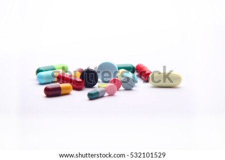 Piles of pills and capsule on white background, isolated. Selective focus