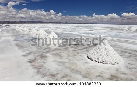 Piles of salt on the surface of the Salar de Uyuni salt lake, Bolivia - stock photo