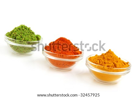Piles of spices. Parsley, oregano, red paprika and curcuma.