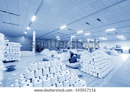 Piles of spindles stacked together in a warehouse