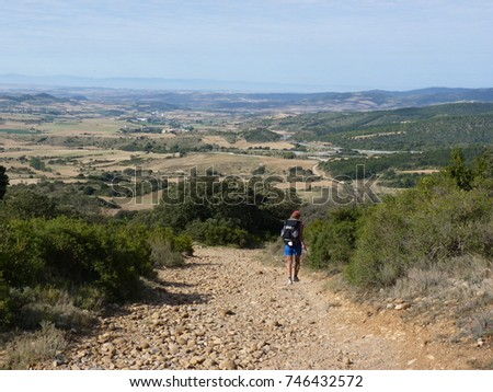 Shutterstock Pilgrim along the way of St. James. Woman walking on Camino de Santiago.