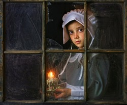Pilgrim Girl with candle by window