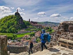 Pilgrims descending from the rock of saint michel, in Puy en Velay. Departure of the way of saint james