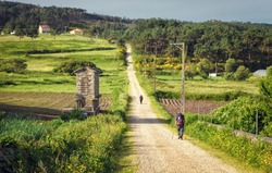 Pilgrims walking along on the Way of St. James, Muxia-Fisterra, Galicia, Spain