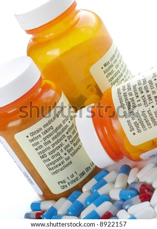Pill bottles surrounded by white, blue, and red capsules on a white background