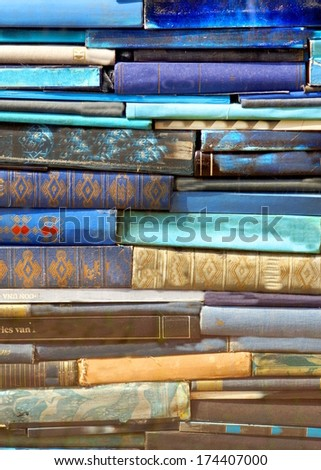pill of blue books stacked together