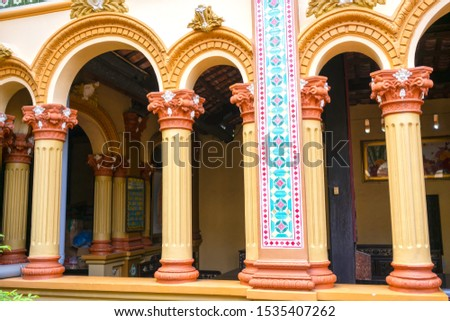Pillar architecture at Vinh Trang temple, My Tho, Vietnam with patterns of 19th-century culture in southern Vietnam