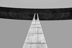 pillar of a large concrete bridge. The image reflects strength and solidity