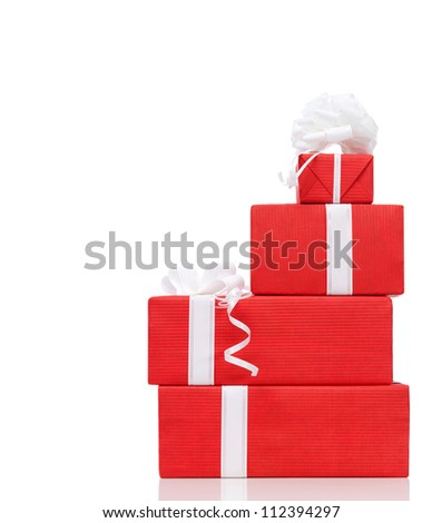 Pillar of boxes with presents wrapped in red paper, isolated on white