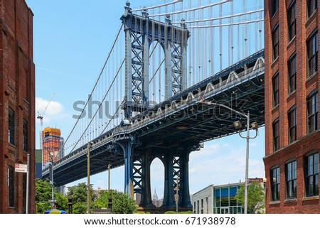 Pillar of Manhattan Bridge as seen from Dumbo district in Brooklyn #671938978