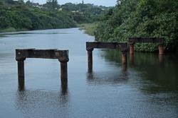 PILLARS OF OLD BRIDGE IN LAGOON