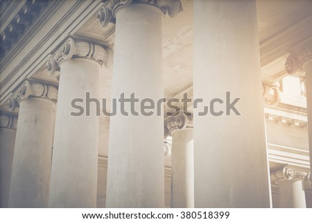 pillars to a courthouse with...
