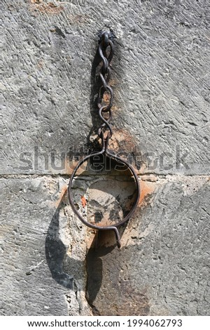 Pillory chains on a medieval church  Stockfoto ©