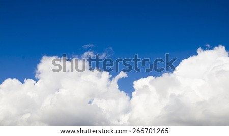 Pillow made of white clouds in the deep blue sky