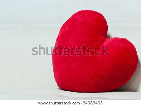 pillow red heart shaped  on white sofa