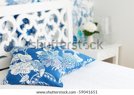 Pillows closeup in nicely decorated bedroom in blue and white colors