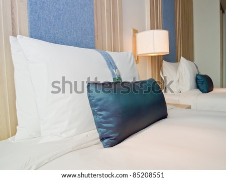 pillows on beds in a luxury hotel's room