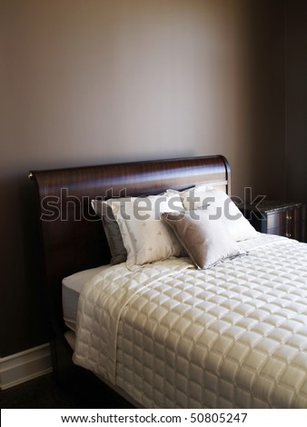 pillows on the bed in the brown bedroom